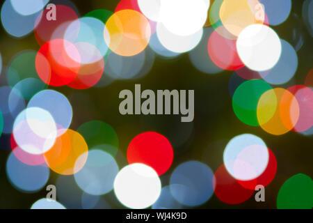 Multicolor Light Orb Background Horizontal Christmas Lights through a long lens - Stock Photo