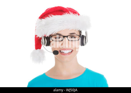 Young casual woman in santa hat and,microphone and headphones. Isolated on white. - Stock Photo