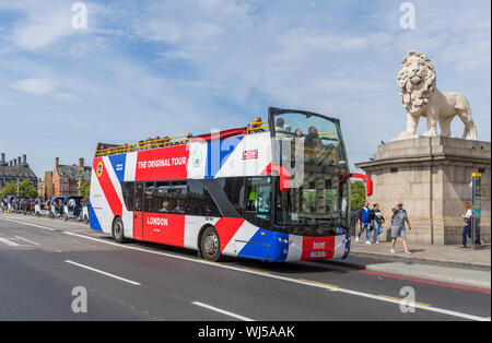 The Original Tour, a tour bus for sightseeing tourists to see London from an open top tours bus on Westminster Bridge, London, England, UK. - Stock Photo