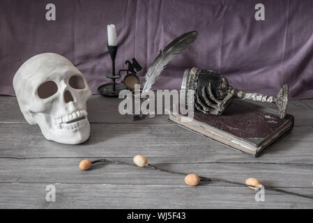 Skull With Ink Well And Quill Pen On Table - Stock Photo