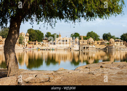 Gadi Sagar (Gadisar) Lake is one of the most important tourist attractions in Jaisalmer, Rajasthan, North India.    Artistically carved temples and s - Stock Photo