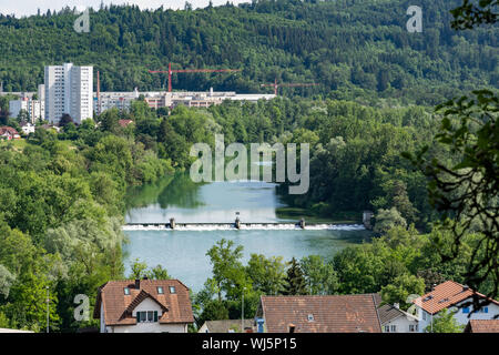 Land view over Umiken and Brugg with dam of old tributary of river Aare - Stock Photo