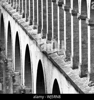 Architectural detail from the Saint Clement Aqueduct, Montpelier, France, shot in black and white. - Stock Photo