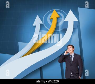Composite image of attractive businessman on mobile phone standing in front of arrows and statistics - Stock Photo