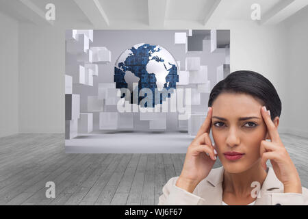 Composite image of young businesswoman putting her fingers on her temples - Stock Photo