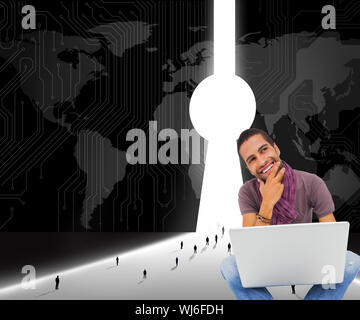 Composite image of thinking man sitting on floor using laptop and smiling on white background - Stock Photo