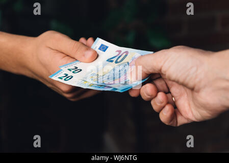 Cropped Image Of Hands Holding Paper Currency - Stock Photo