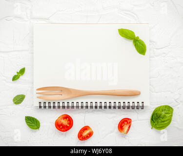High Angle View Of Book With Leaves And Wooden Fork On Table - Stock Photo