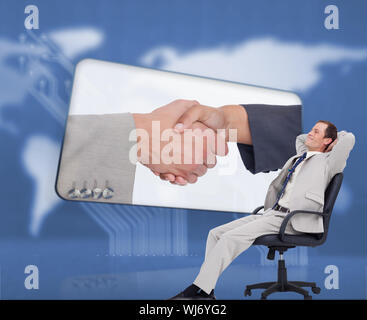 Composite image of side view of businessman leaning back in his chair against a white background - Stock Photo