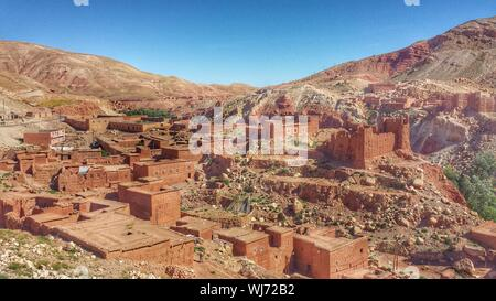 High Angle View Of Old Houses And Mountains Against Clear Sky - Stock Photo