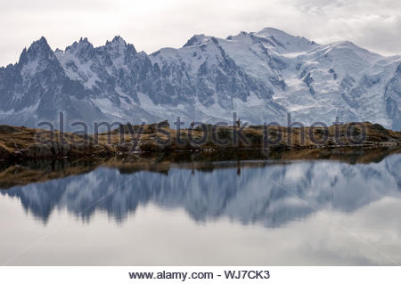 Mont Blanc massif reflected in a tarn, Lacs des Chéserys, Chamonix, France - Stock Photo