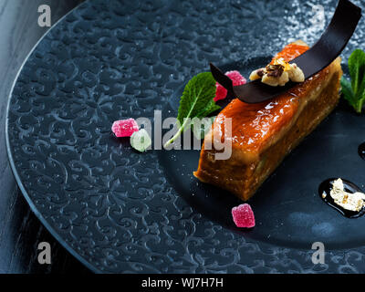 Marzipan dessert. Marzipan is a confection consisting primarily of sugar or honey and almond meal (ground almonds), sometimes augmented with almond oi - Stock Photo