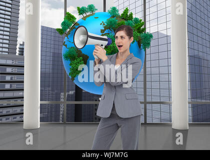 Composite image of businesswoman with loudspeaker - Stock Photo