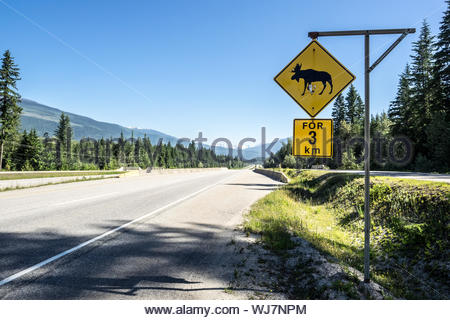 Close-up Of Road Sign Against Clear Sky - Stock Photo