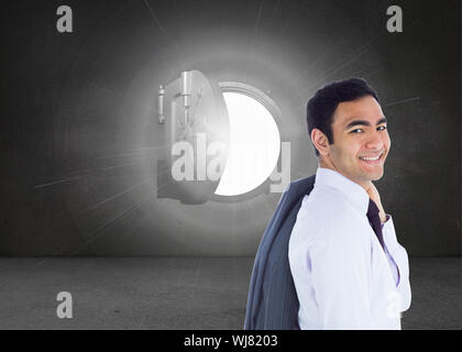 Composite image of smiling businessman standing - Stock Photo