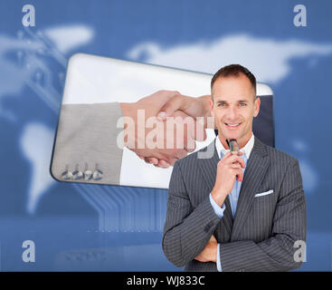 Composite image of smiling businessman holding glasses isolated on a white background - Stock Photo