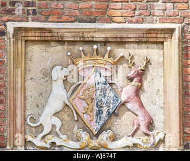 Royal emblem on a wall at the college of St John, university of Cambridge, England. - Stock Photo