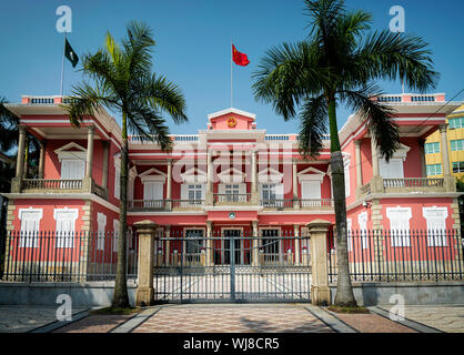 chinese government headquarters colonial heritage building landmark exterior in macau city at daytime - Stock Photo
