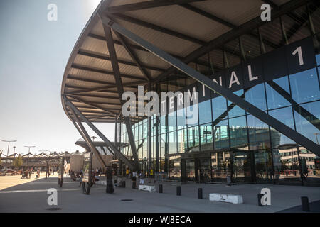LYON, FRANCE - JULY 13, 2019: Main entrance to Terminal 1 of Aeroport de Lyon Saint Exupery Airport, formerly Satolas, the main international airport - Stock Photo