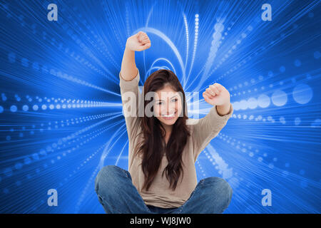 Composite image of a woman celebrating in front of her laptop as she smiles looking forward. - Stock Photo