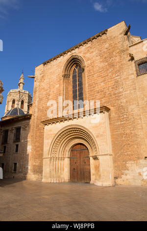 Valencia Cathedral romanesque door Puerta del Palau Almoina and Micalet Seu at Spain - Stock Photo