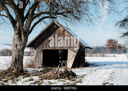 Abandoned House On Snow Covered Land During Winter - Stock Photo