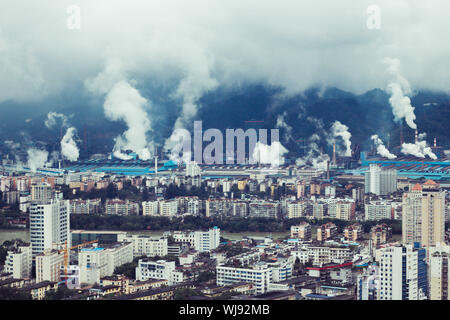 High Angle View Of Smoke Emitting From Industries By Cityscape - Stock Photo
