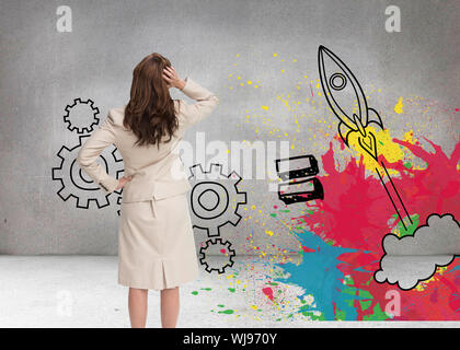 Composite image of businesswoman standing back to camera with hand on head - Stock Photo