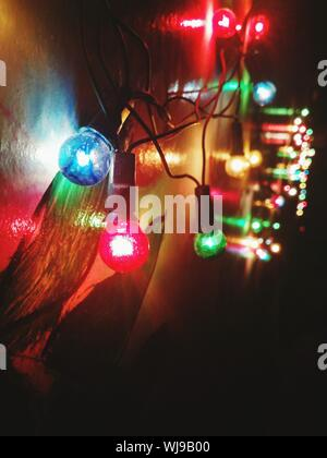 Low Angle View Of Illuminated Lights On Wall - Stock Photo