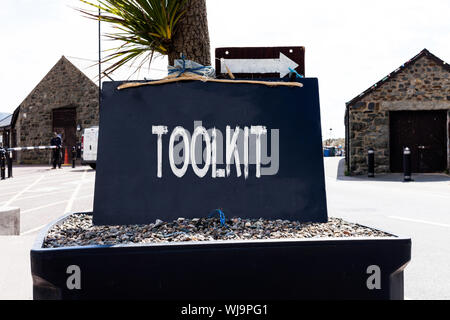 Text sign showing Toolkit. Business photo showcasing set of tools kept in a bag or box and used for a particular purpose Empty black board with copy s - Stock Photo