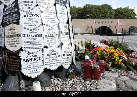 Warsaw Poland - the entrance to the Pawiak prison used as a torture centre by the German Nazis in WW2 with memorial plaques to the victims. - Stock Photo
