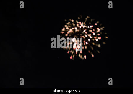 Low Angle View Firework Display At Night - Stock Photo