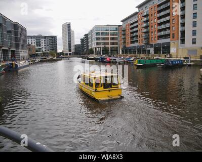 blue sign Leeds dock home of the armouries and water taxi Twee on the river Aire Leeds Yorkshire England - Stock Photo