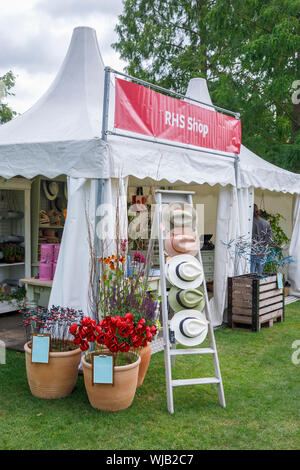 RHS Shop stall with a display of hats for sale at the September 2019 Wisley Garden Flower Show at RHS Garden Wisley, Surrey, south-east England - Stock Photo
