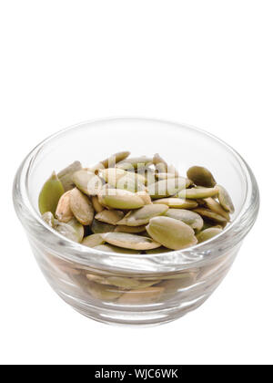 close up of a bowl of pumpkin seeds isolated - Stock Photo