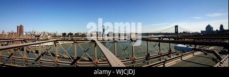 Panoramic View Of Manhattan Bridge Over East River Against Sky Seen From Brooklyn Bridge - Stock Photo