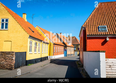 Danish city streets with colorful buildings on the island of Bornholm in the summer - Stock Photo