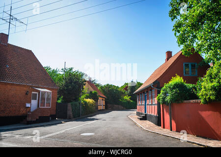 Streets of Denmark with colorful buildings on the island of Bornholm in the summer - Stock Photo