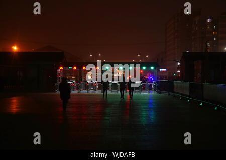 Rear View Of People Walking Towards Subway Platform - Stock Photo