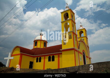 Yellow church in the State of Hidalgo, Mexico. - Stock Photo