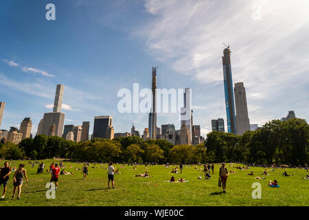 Billionaire's Row, a collection of super-tall residences for the uber-rich mostly on West 57th Street, from the Sheep Meadow in Central Park on Saturday, August 31, 2019. (© Richard B. Levine) - Stock Photo