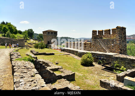 Tsarevets fortress with the remains of medieval houses on the top of the hill. Veliko Tarnovo, Bulgaria - Stock Photo