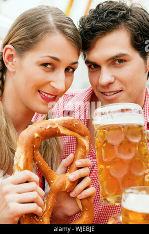 Couple in a beer tent - Stock Photo