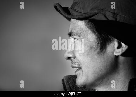 Here are a Chinese middle-aged man in the outdoor. - Stock Photo