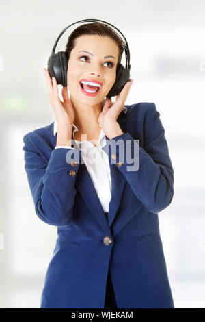 Young beautiful woman is listening to music. - Stock Photo