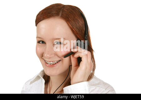 Smiling young girl wearing a headset - Stock Photo