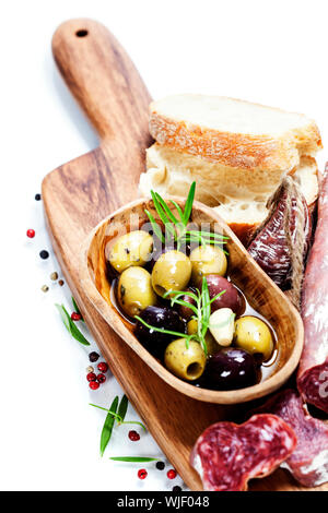 Italian salami with olives and ciabatta on white background - Stock Photo