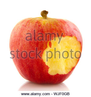 Eating a red apple isolated over white - Stock Photo