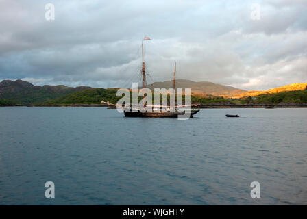 M.V.Bessie Ellen Anchored in Loch Na Droma Buidhe Oronsay Sound of Mull Scotland United Kingdom port side sunset view 1904 William Kelly Plymouth buil - Stock Photo