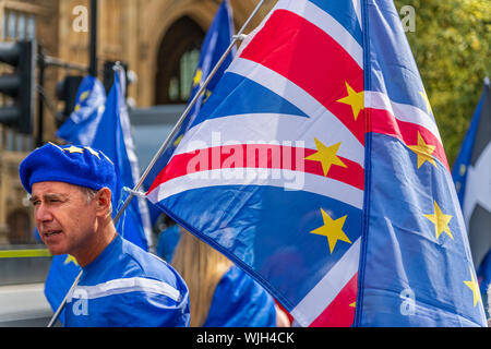 Westminster, London, England. 3rd September, 2019. A Stop Brexit demonstrator joins fellow protestors at a 'Stop the Coup' rally outside the Houses of Parliament. Terry Mathews/Alamy Live News - Stock Photo
